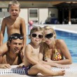 Happy young family have fun on swimming pool — Stock Photo #4993647