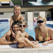 Happy young family have fun on swimming pool — Stock Photo #4994037