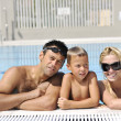 Happy young family have fun on swimming pool — Stock Photo #4994181