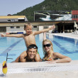 Happy young family have fun on swimming pool — Stock Photo