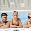 Happy young family have fun on swimming pool — Stockfoto