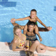 Happy young family have fun on swimming pool — Stock Photo #4994575