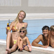 Happy young family have fun on swimming pool — Stock Photo #4994970