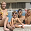 Happy young family have fun on swimming pool — Stock Photo #4995037