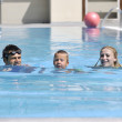 Happy young family have fun on swimming pool — Stock Photo #4995050