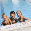 Happy young family have fun on swimming pool — Stock Photo #4995092