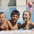 Happy young family have fun on swimming pool — Stock Photo #4995122