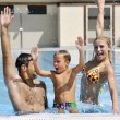 Happy young family have fun on swimming pool - Stock fotografie