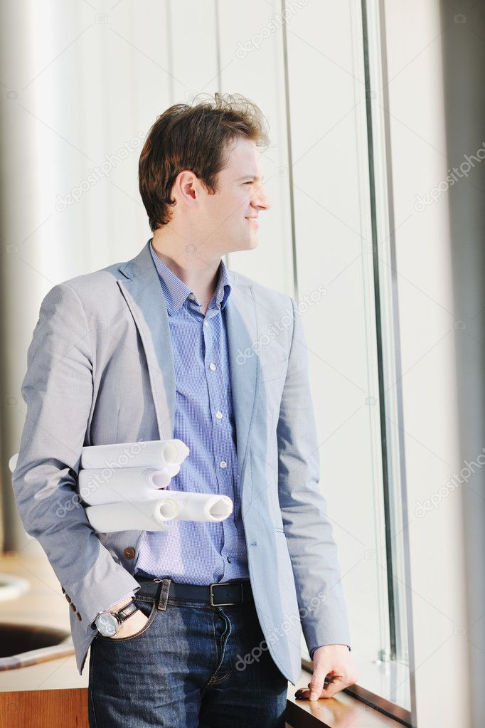Young business man talk by cellphone over bright window in big hall  — Stock Photo #5152200
