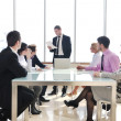 Group of business at meeting - 