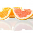 Stock Photo: Orange and grapefruit peaces