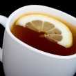 Close-up cup of tea with lemon on black — Stock Photo #2855850