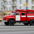 Fire-engine in motion - Stock Photo