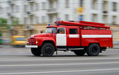 Fire-engine in motion — Stock Photo