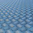 Polished metal diamond plate - Stock Photo