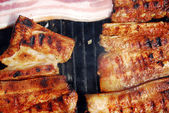 Pork chops on grill — Stock Photo
