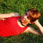 Girl in green grass — Stock Photo