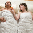 Couple in bed — Photo