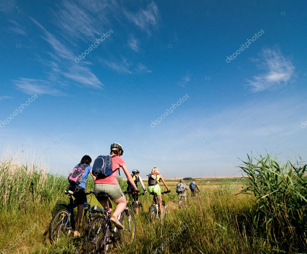 Mixed group of cyclists biking summer day  Stock Photo #2746522