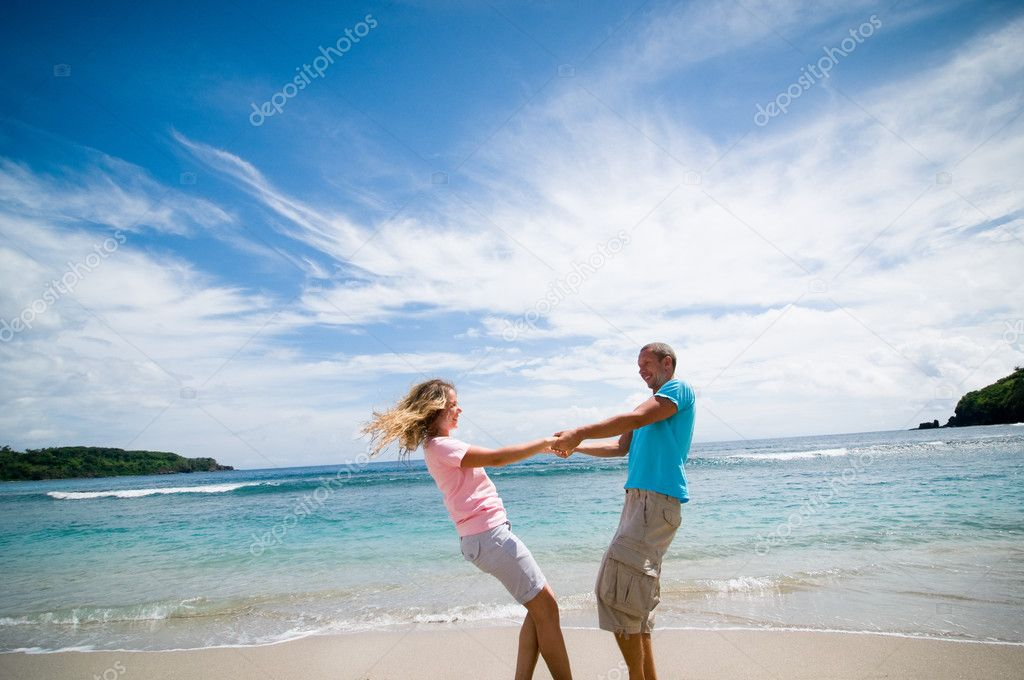 Couple having fun at seaside  Stock Photo #3542581