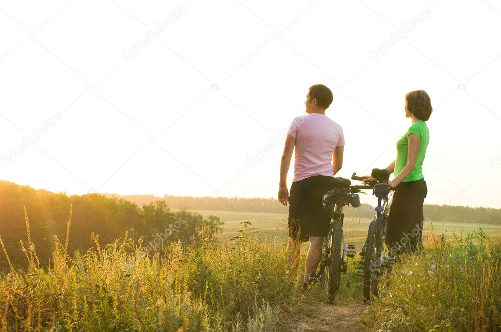 Two cyclists relax biking outdoors — Stock Photo #3542648