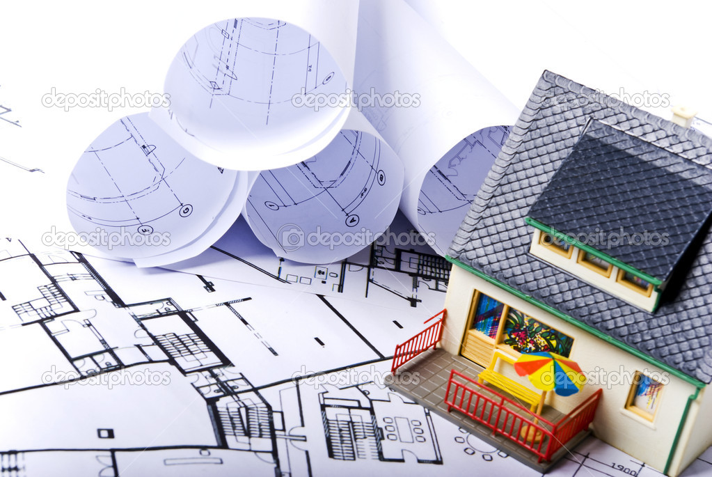 Model house with some plans documents — Stock Photo #3147168