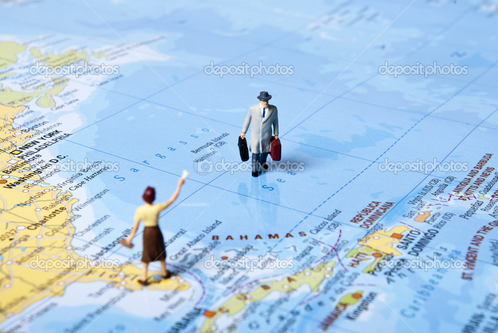 Miniature man on world map — Stock Photo #3564902