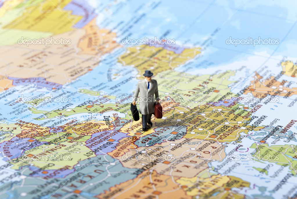 Miniature man on world map — Lizenzfreies Foto #3565008