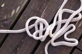 Rope on wooden boards — Stock Photo