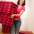 Stock Photo: WomMoving Into New Home