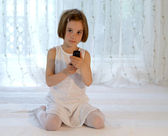 Child with mobile phone - cellphone with SMS — Stock Photo