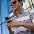 Young businessman with mobile phone — Stock Photo