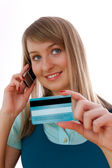 Young woman with credit card and cellphone — Stock Photo