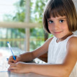 Elementary school pupil writing — Stock Photo
