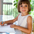 Stock Photo: Elementary school pupil writing