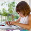 Elementary school pupil homeworking at desk — Stock Photo