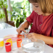 Schoolchild painting with hands — Stock Photo