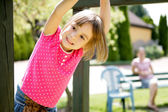 Mother and daughter having fun on playground — ストック写真
