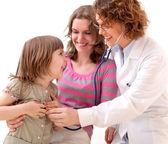 Female doctor examining happy child — Stock Photo