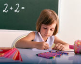 Young pupil writing in a classroom - New school year — Stock Photo