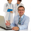 Portrait of a male doctor with two of his co-workers — Stock Photo #3743410