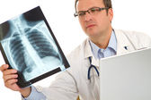 Male doctor examining an x-ray image — Stock Photo