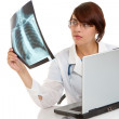Stock Photo: Doctor examining an x-ray image