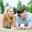 Young happy couple relaxing at park — Stock Photo