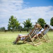 Young couple relaxing ouside - Stock Photo