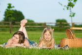 Mother and daughter having picnic — Stock Photo
