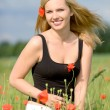 Sexy woman on poppy field - Foto Stock