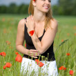 Sexy woman on poppy field - Stock Photo