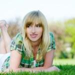 Beautiful woman relaxing in grass — Stock Photo #2794976