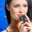 Young Woman Singing into Microphone — Stock Photo